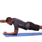 Strong man doing one arm plank exercise