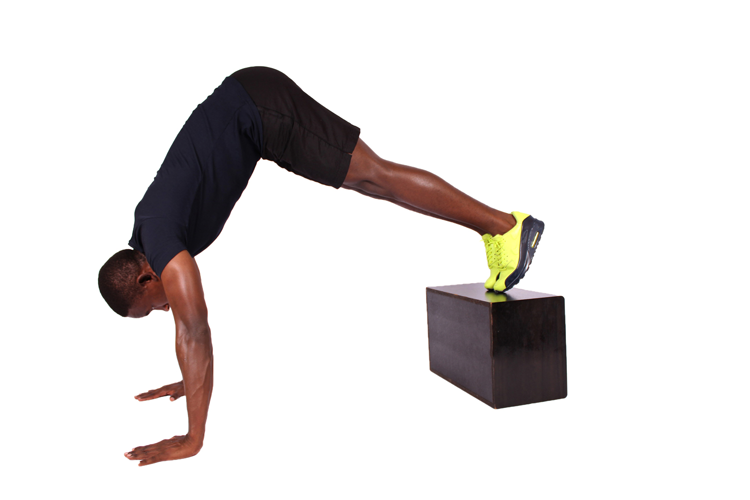Strong man doing pike push ups with feet elevated