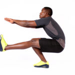 Strong man doing pistol squat exercise one leg squat