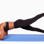 Strong woman doing plank with leg raised