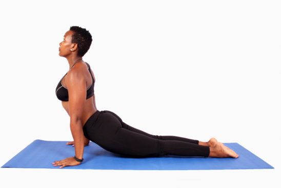 Strong woman doing yoga pose