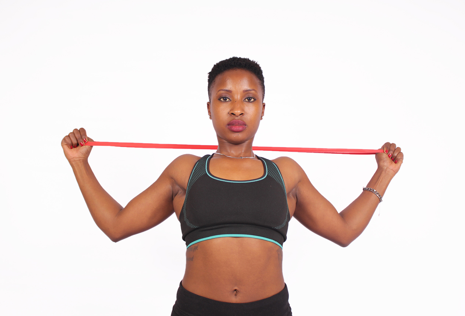 Strong woman exercising with resistance bands
