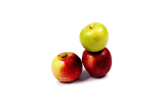 Two red apples and one green apple on isolated white background