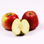 Two red apples and one slice of green apple on white background