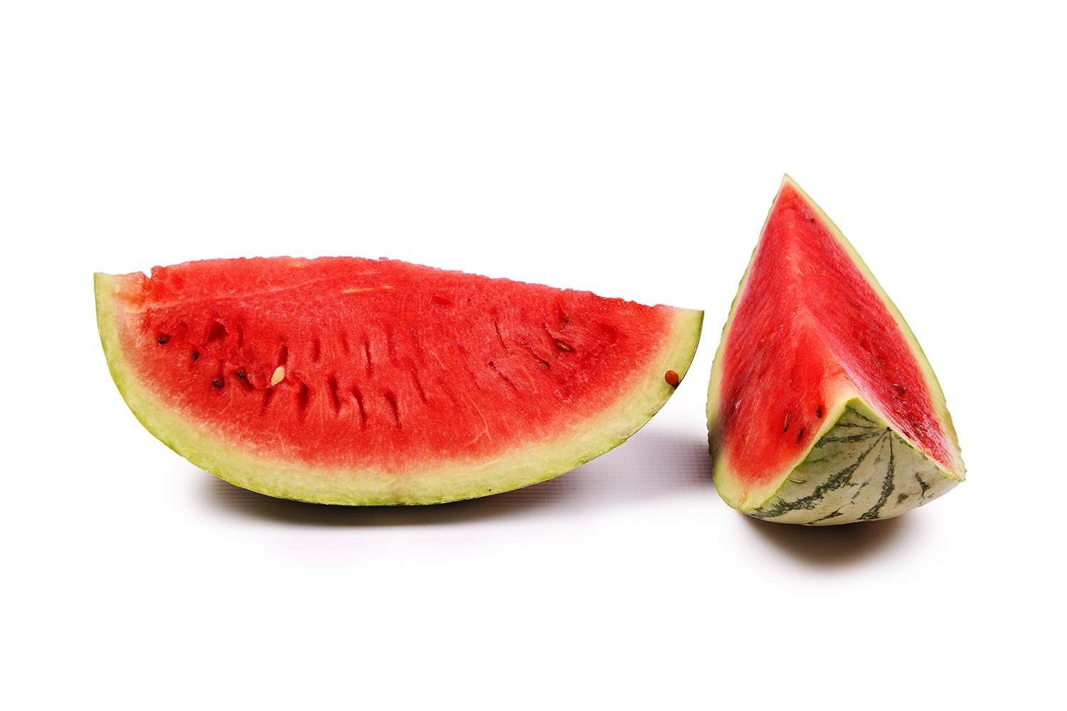 Two slices of watermelon on isolated white background
