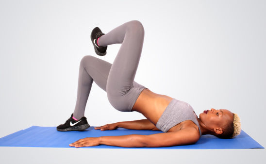 Woman Doing single leg glute bridges one leg raised