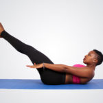 Woman doing ab exercise with legs raised