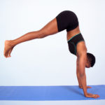 Woman doing handstand yoga pose