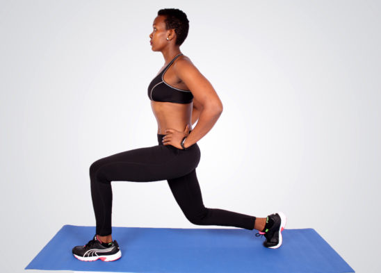 Woman doing lunges on yoga mat