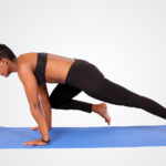 Woman doing mountain climbers ab exercise