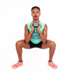 Woman doing squats with dumbbells