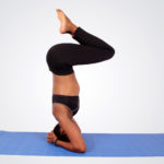 Woman doing yoga head stand pose
