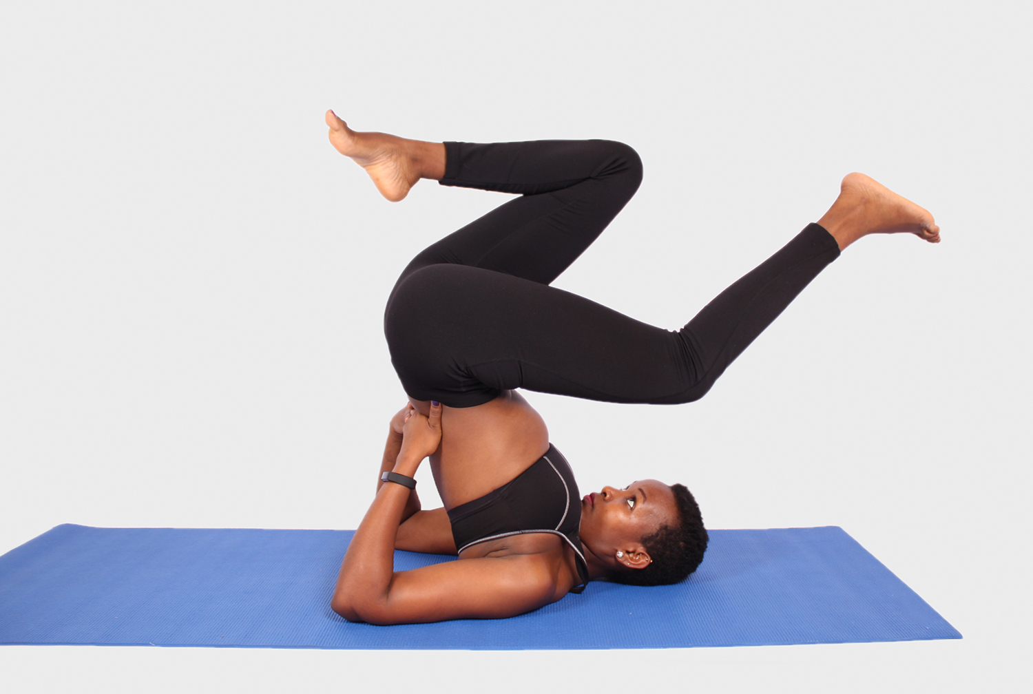 Woman doing yoga pose for neck and back muscles
