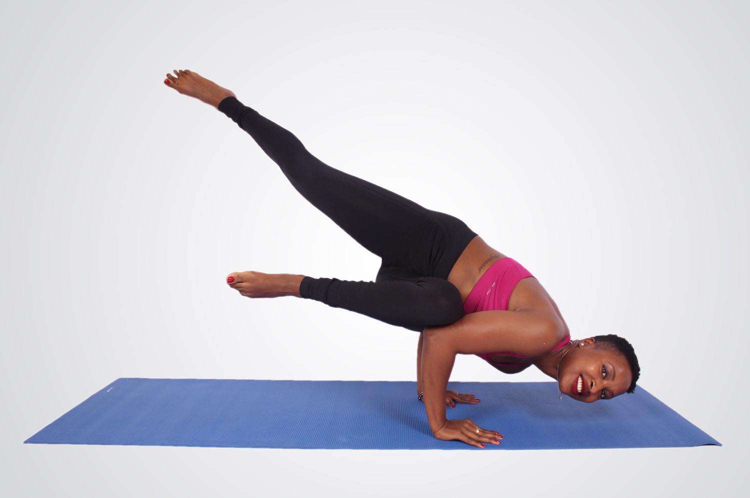 Woman doing yoga pose legs in the air