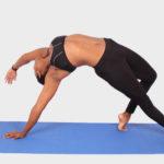 Woman doing yoga pose on blue yoga mat