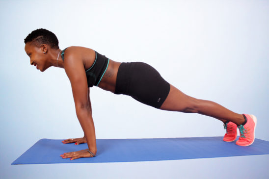 Woman in plank and push ups starting position