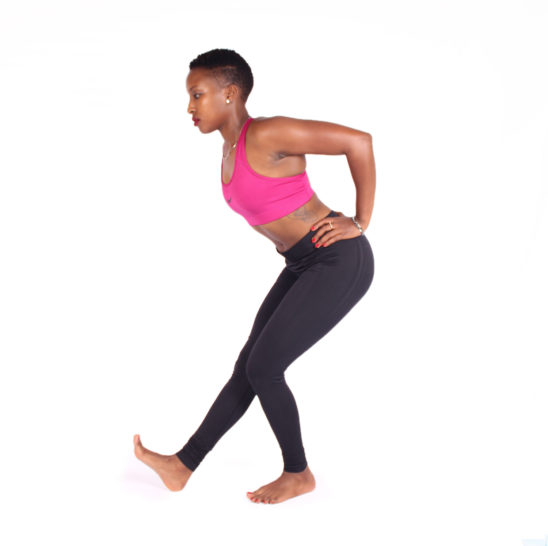 Woman stretching calves and hamstrings