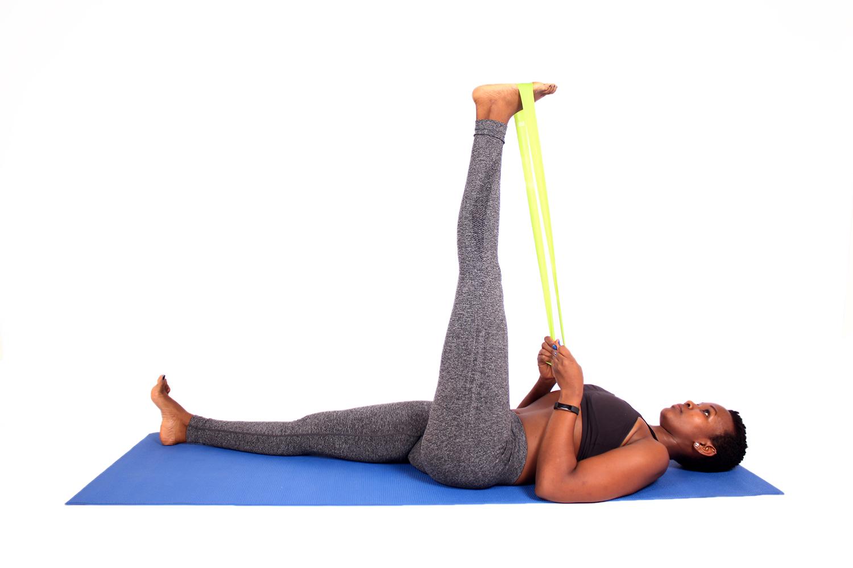 Woman Stretching Leg Using Resistance Band