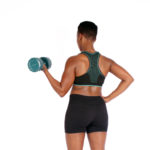 Toned Woman With Biceps and Back Muscles Lifting Dumbbells