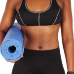 Fitness Woman With Abs Carrying Yoga Mat