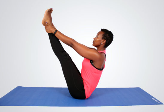 Yoga woman doing balancing exercise