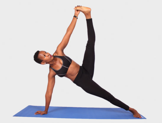 Yoga woman doing pose on yoga mat