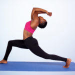 Yoga woman doing stretch on yoga mat
