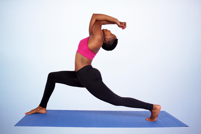 Yoga woman doing stretch on yoga mat