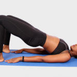 Yogi doing glute bridges exercise