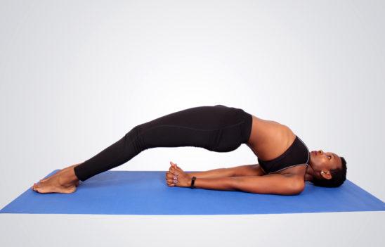 Yogi practicing yoga on yoga mat