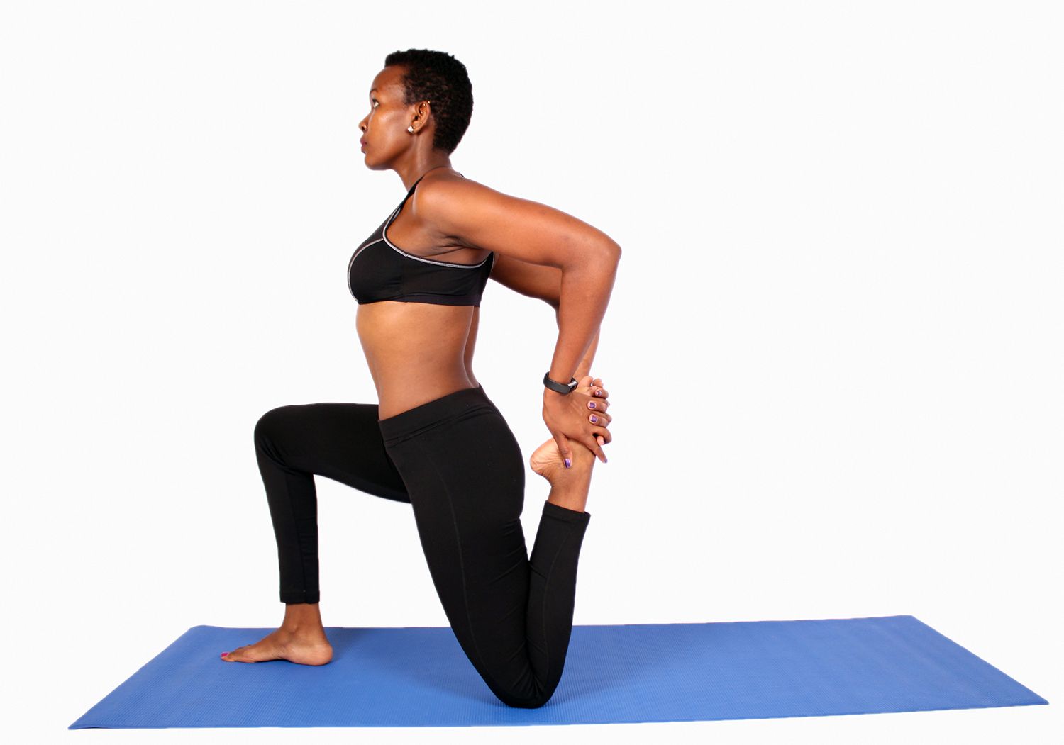 Young african woman doing yoga stretch