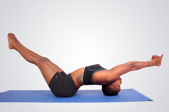 Young athletic woman doing yoga pose