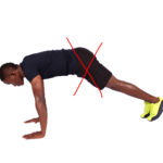Young fit man not doing push ups properly