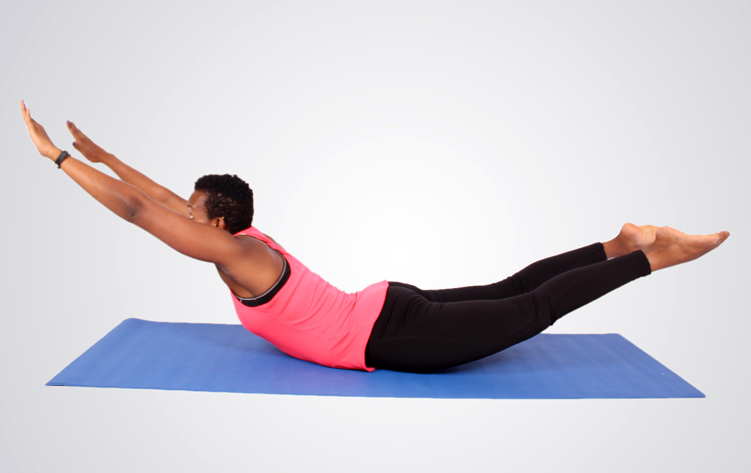 Young Fit Woman Doing Superman Core Exercise for Lower Back