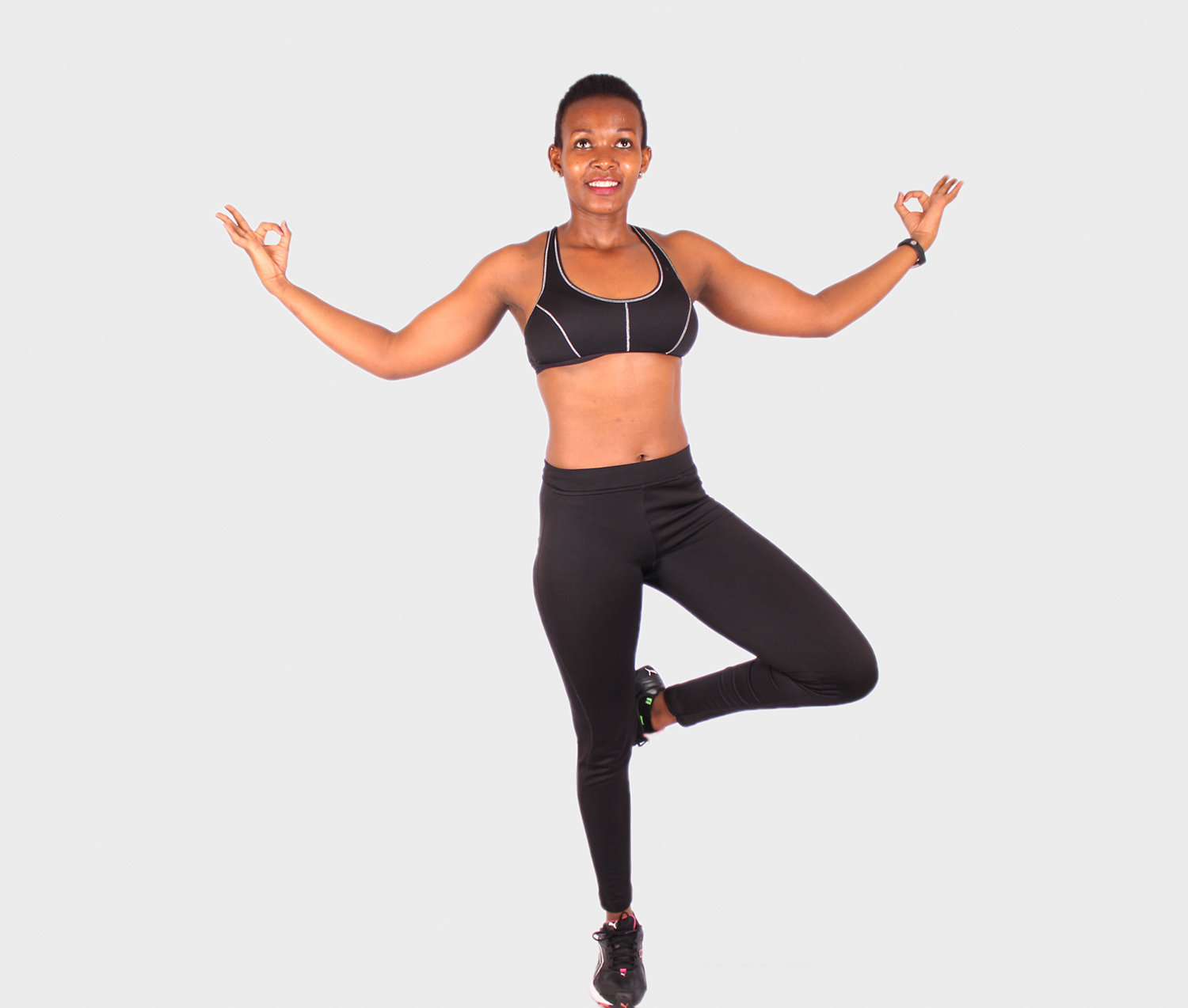 Young fitness woman practicing yoga