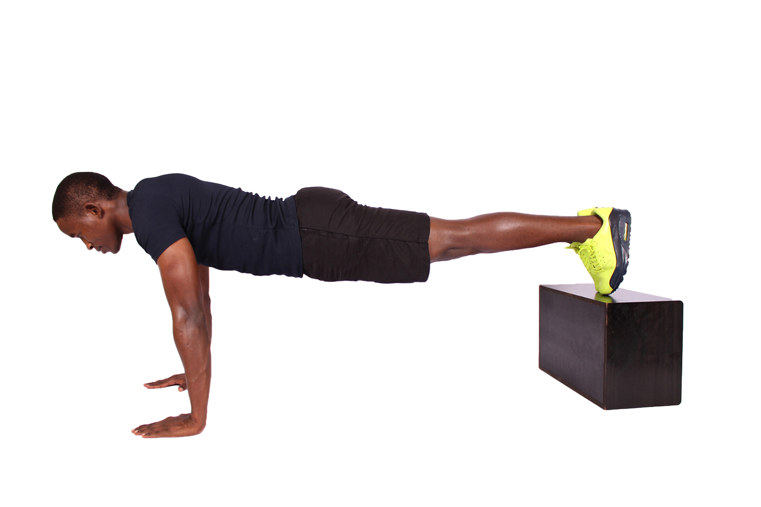 Young man doing decline push ups with feet elevated