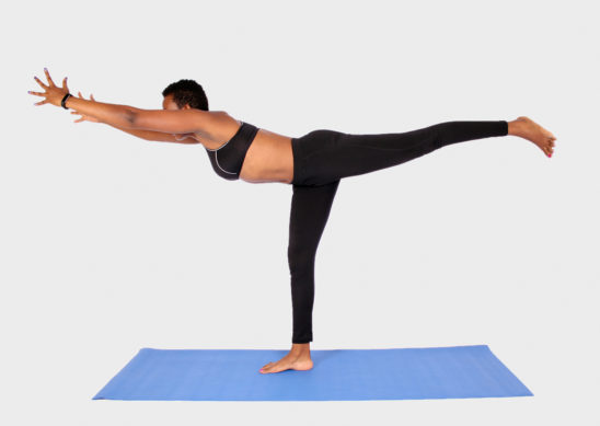 Young woman doing balance yoga pose