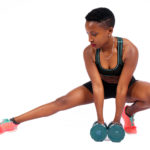 fitness woman stretching holding dumbbells