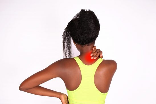 Fitness Woman Grabbing Neck Due to Neck Pain