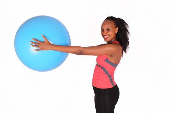 Beautiful woman exercising with stability ball