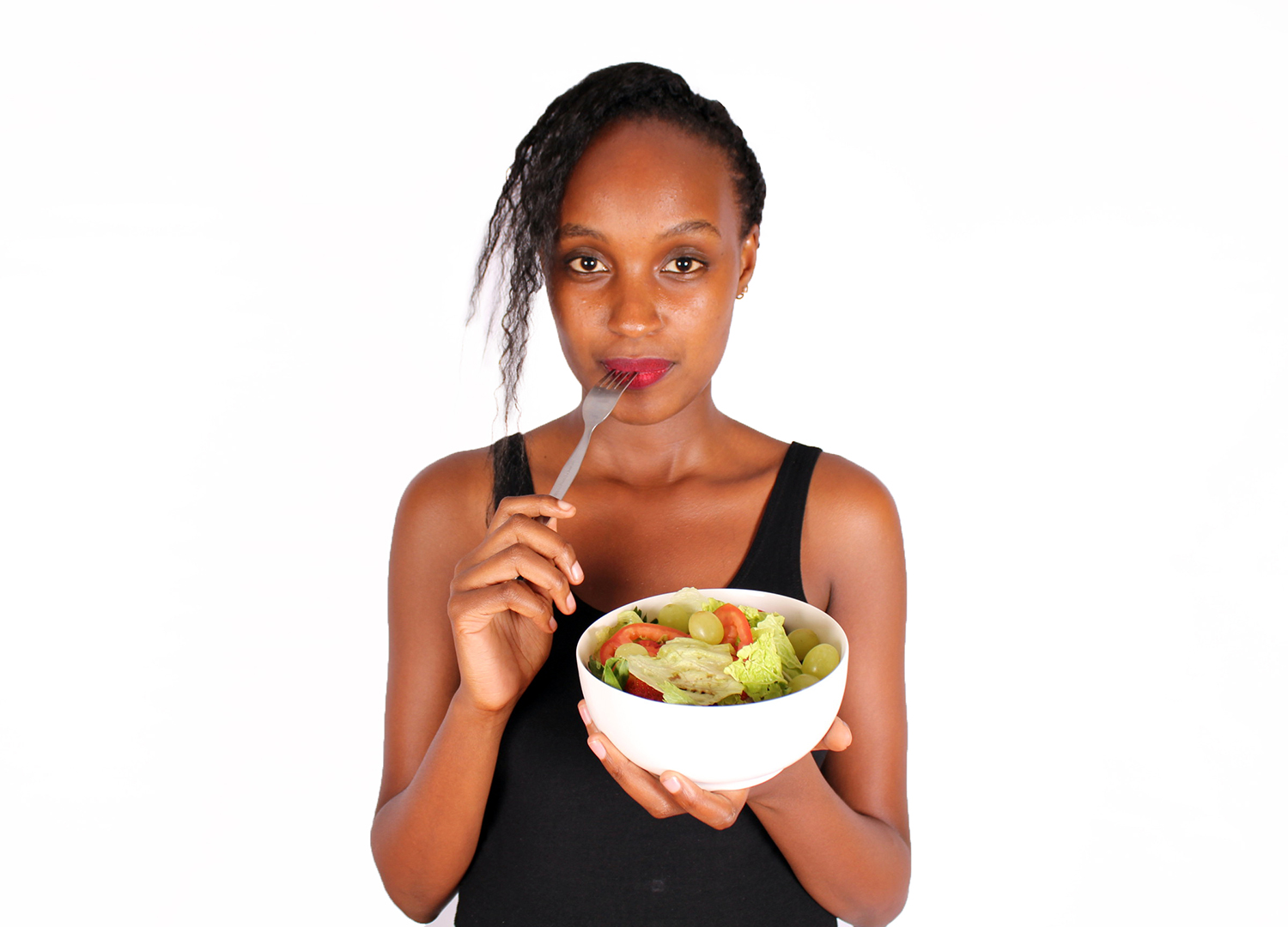 Beautiful woman holding a bowl of veggies and fruits