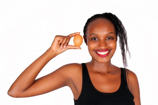 Close Up Smiling Woman Holding Egg