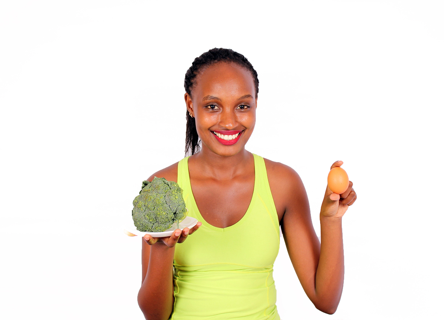 Beautiful woman holding egg and broccoli healthy lifestyle