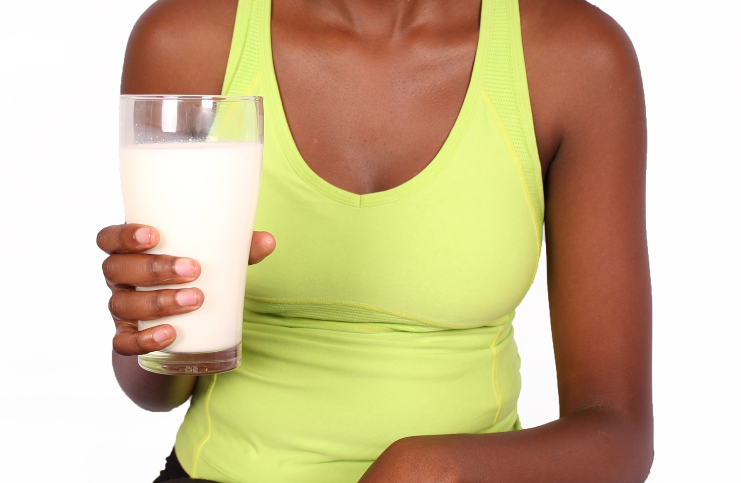 Black woman holding glass of milk