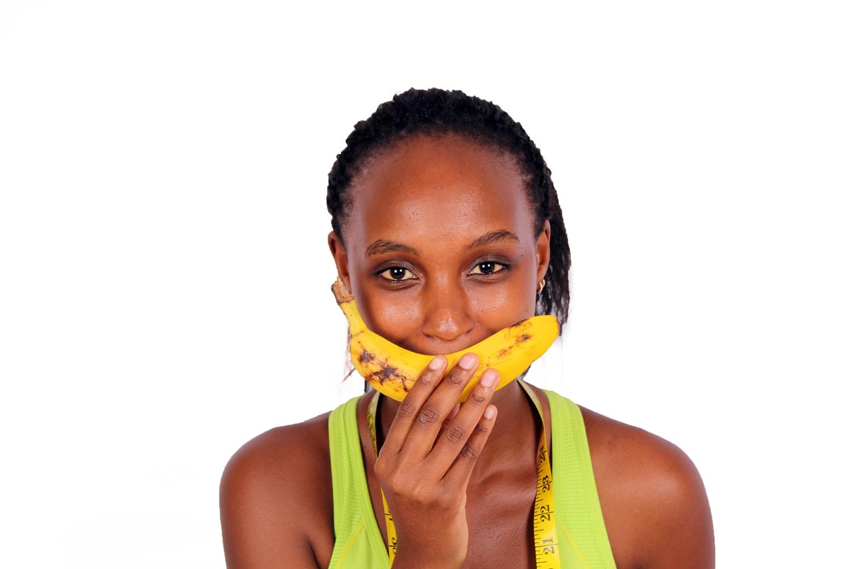 Close up Dieting woman holding banana