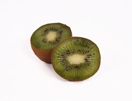 Close up two sliced kiwi fruits