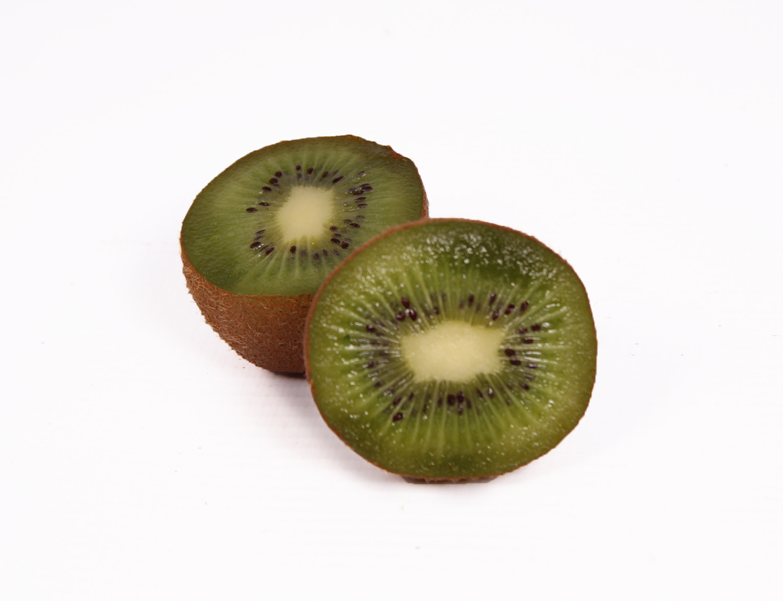 Close up two sliced kiwi fruits