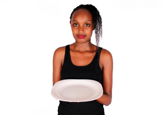 Hungry Woman Holding Empty Plate