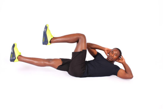 FItness man demonstrates how to do bicycles ab exercise