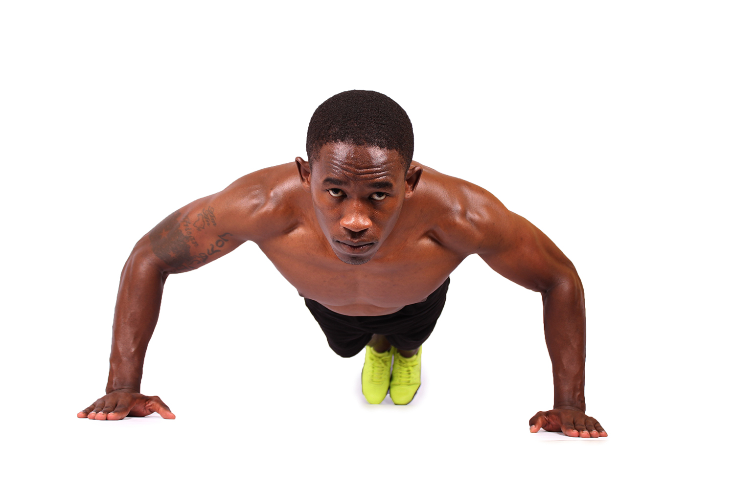 Fit athletic man doing push ups exercise